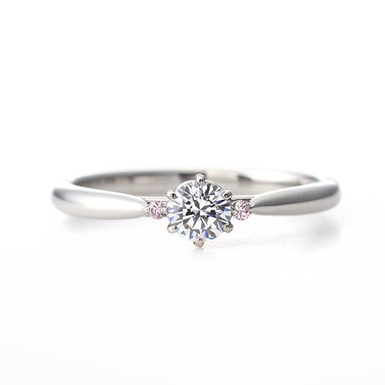 ピンクダイヤモンドをサイドに施したシンプルなエンゲージリング。