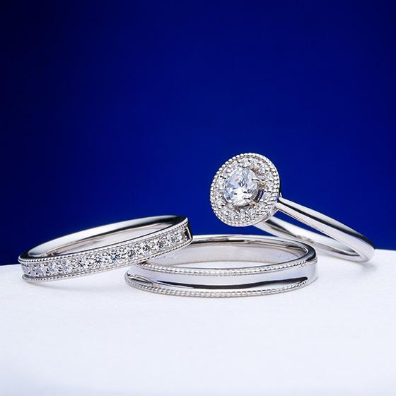 ミル打ちでセット感を出したゴージャスなリング。ダイヤモンドの7色の輝きとミル打ちの艶めく輝きが上品な女性をイメージ。
