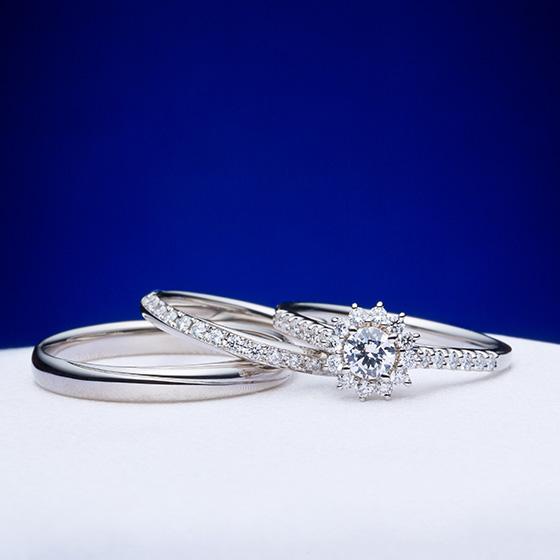 大輪のダイヤモンドの花を咲かせたセットリング。