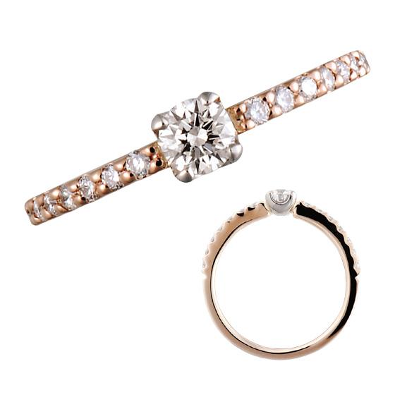 細身のアームにきらきらと散りばめたダイヤモンドが、指いっぱいに広がる婚約指輪。