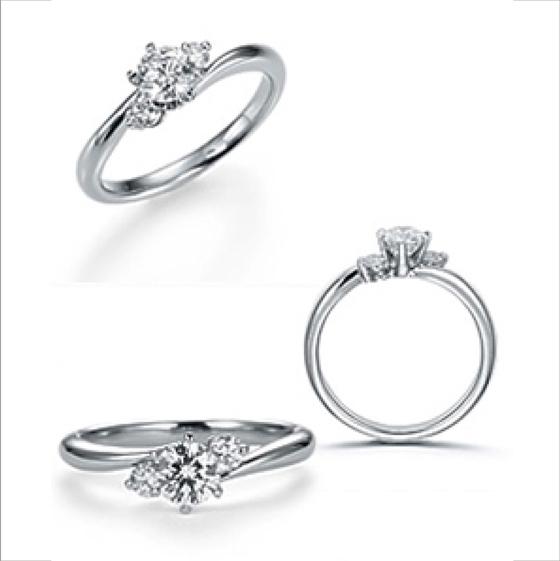 丸みのある緩やかなフォルムが、ダイヤモンドの輝きを包み込むかのようなデザイン。中央に向かって絞りのあるプラチナが女性のお指を美しく演出する。