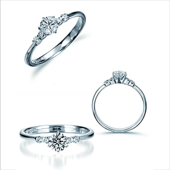 中央のダイヤモンドに目を奪われるよう、サイドメレの大きさに配慮したデザイン。主役のダイヤモンドを更に輝かせる細身のリング。
