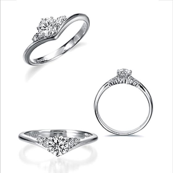 V字のリングは、指を長く細く見せる効果があり中央のダイヤモンドにむかってきらめきが集中する。