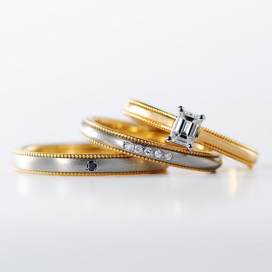 シャープな印象の婚約指輪と、丸みのある優しい印象の結婚指輪を重ねて。違うテイストの2つのリングをミル打ちのデザインが調和している。
