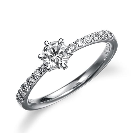 サイドにグラデーションのダイヤを一文字に置いて、シンプルでありながら豪華で存在感を醸し出したデザインです。