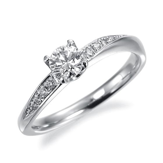 サイドのメレダイヤがS字のラインを描き、センターダイヤの輝きを更に大きく感じさせるエレガントなデザインです。