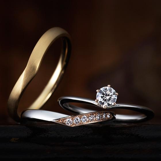 ダイヤモンドを留める部分を、ピンクゴールドであしらったおしゃれなセットリング。