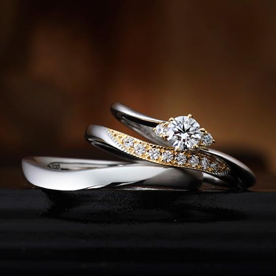 ダイヤモンドを囲む部分をゴールド素材にすることで、より華やかな印象に仕上げたセットリング。