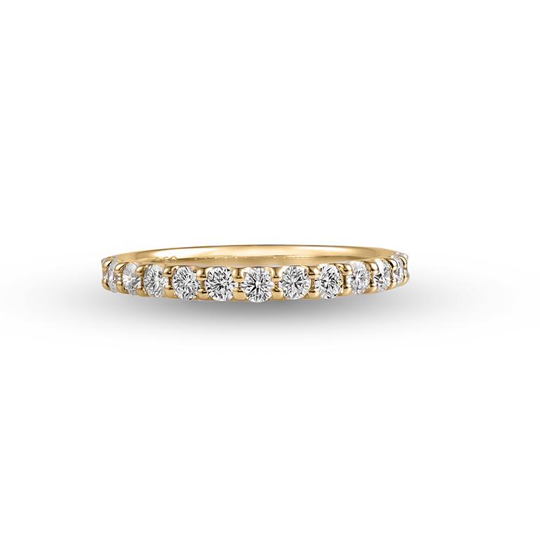 爪留めタイプのハーフエタニティリング。K18(イエローゴールド)がダイヤモンドをより華やかに見せてくれます。