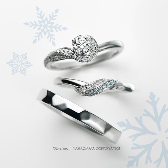 アナとエルサを2色のダイヤと表面加工で表現したセットリング。