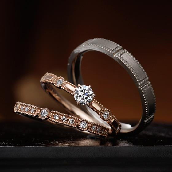 ミル打ちとダイヤモンドでクラシカルなイメージのセットリング。