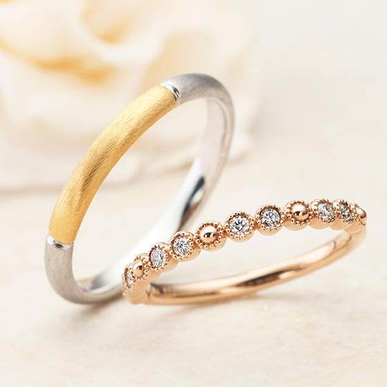 細身のシルエットにダイヤモンドをかわいらしく留めたマリッジリング。