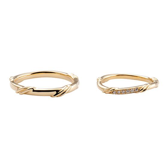 緩やかにカーブを描く、個性派なデザイン。二人の硬く結ばれた絆の強さをイメージし、仕上げた結婚指輪です。