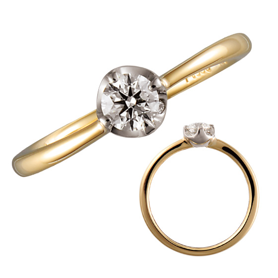 コロンと丸いツメでダイヤモンドを支える婚約指輪。丸みのある印象が強く、ふんわりと柔らかな彼女様をイメージさせる。