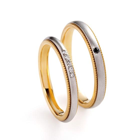 ゴールド×プラチナのコンビネーションリング。サイドのミル打ち部分はゴールドで作られているので、華やかな印象に。