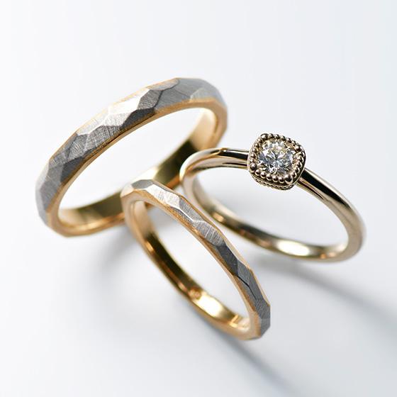 ミル打ちで囲まれたダイヤモンドとゴールドの色味がアンティックのイメージを作りだすセットリング。