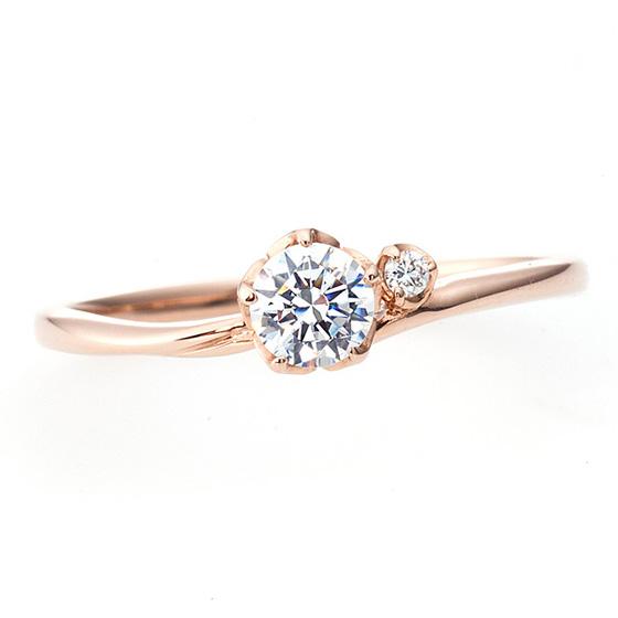 やわらかな曲線を描いた婚約指輪。ダイヤモンドを5点で留め、花弁のイメージをさせる婚約指輪。