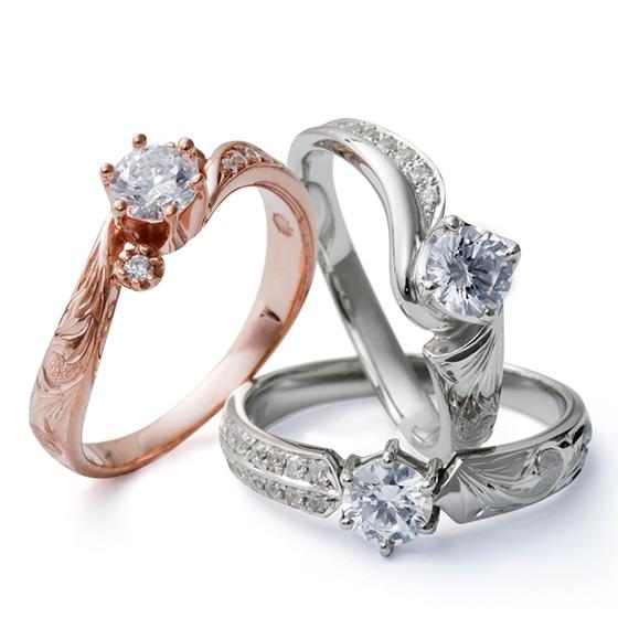 ハワイアンの彫模様が施された婚約指輪。程よいボリューム感がゴージャスで存在感があり、彫模様もきれいにみえます。