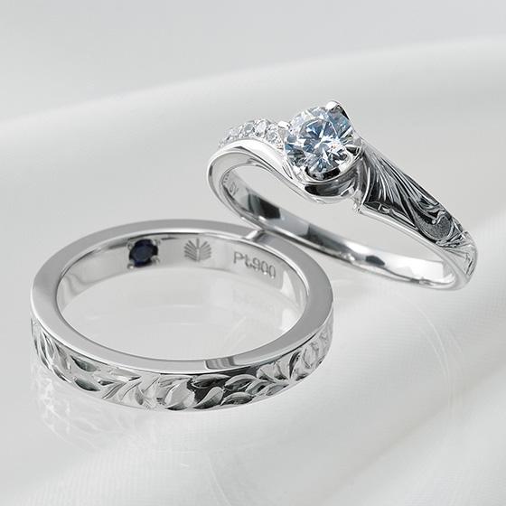 大粒のダイヤモンドにも負けない迫力ハワイアンジュエリーの婚約指輪とスリムタイプで普段使いしやすいハワイアンジュエリーの結婚指輪。
