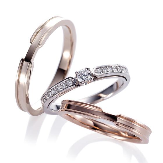 エタニティリングとエンゲージリングを両方楽しめるようなデザインはセンターのダイアモンドを両側のリングが持ち上げているような立体的なフォルム。