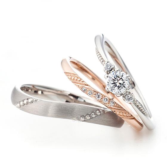 ミル打ちでセット感を表現したセットリング。動きのあるカーブラインのデザインにダイヤモンドのセッティングを抑えることで普段使いしやすいつくりになっています。
