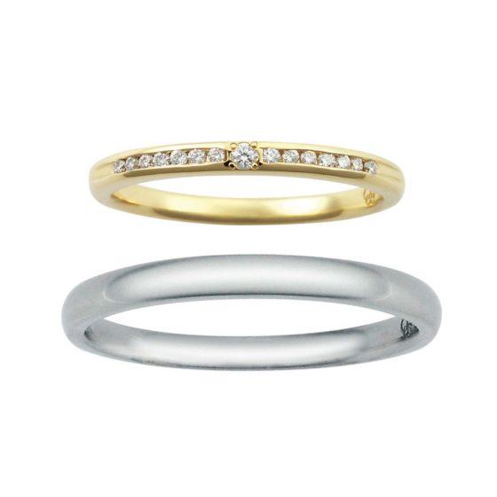 シンプルなストレートタイプの結婚指輪(マリッジリング)レディースにはハーフエタニティの様にダイヤがキラキラしていて、真ん中のダイヤモンドが少し大きめなので存在感があります。