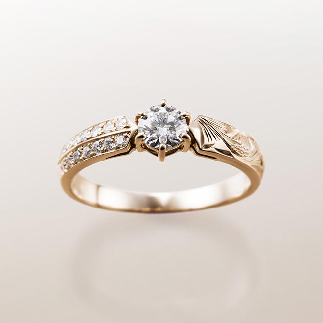 片側にはスクロール(波)もう片側には、二人を祝福する花をイメージしたメレダイヤモンドがセッティングされています。