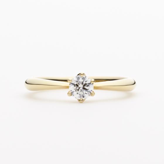 >洗練されたシンプルなデザインの婚約指輪。丸身のある、女性らしい優しいフォルムが人気のデザイン。