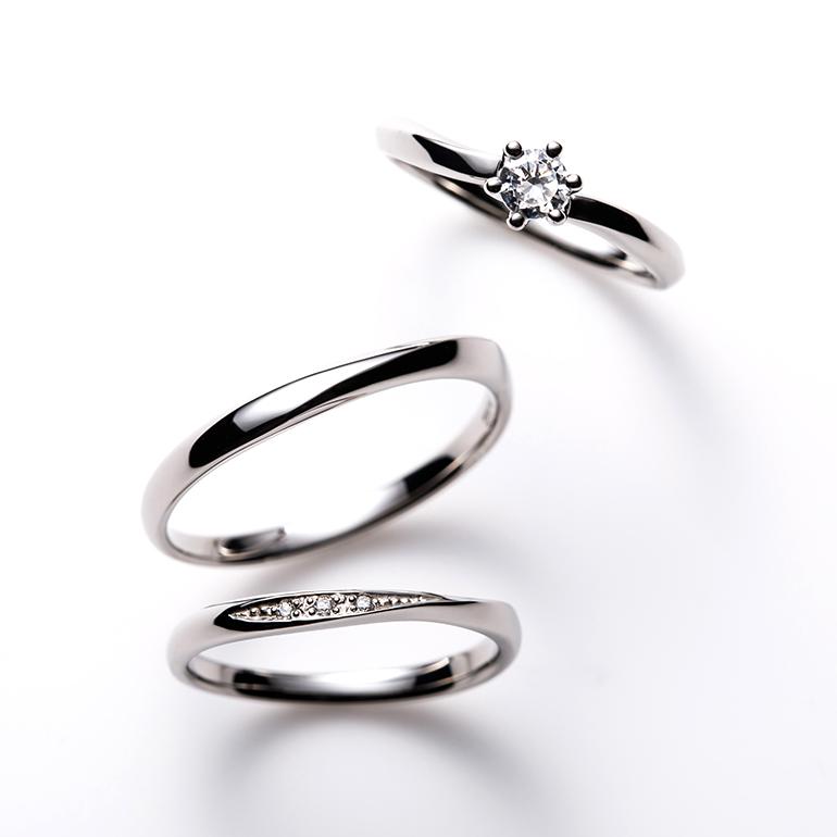 しっかりとしたウェーブラインのソリティアタイプの婚約指輪とシンプルなウェーブラインの結婚指輪のセットリング