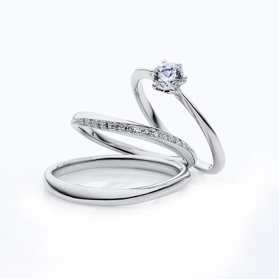 結婚指輪の緩やかな流線形に留められたダイヤモンドの輝きが美しいセットリングです。
